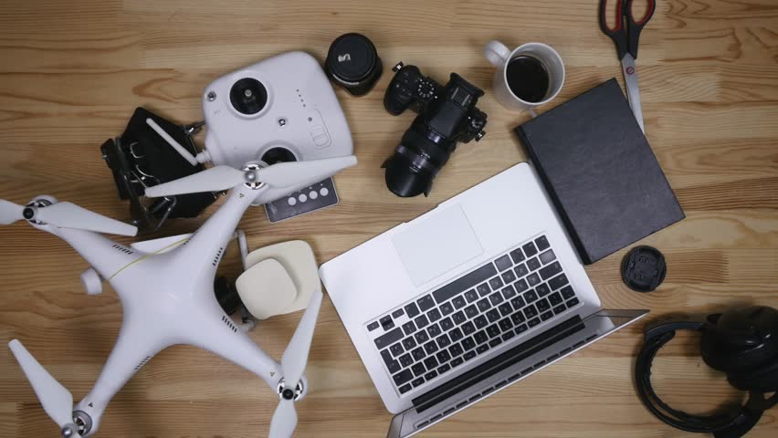 Top view photographer cleaning lens working at desk from above. | Shutterstock HD Video #25062668