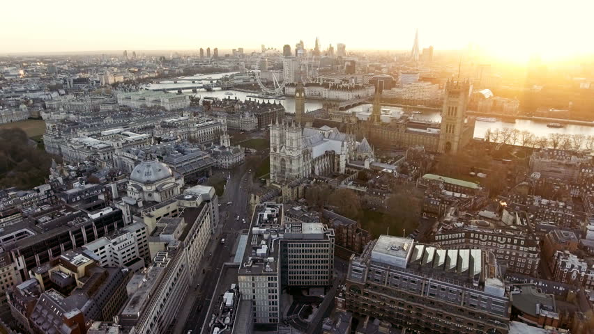 Panoramic Aerial Shot of Houses of Parliament & Big Ben in Central London features The London Eye Wheel, River Thames and Iconic Business Buildings Skycrapers with Beautiful Sunrise 4K   Shutterstock HD Video #25065833
