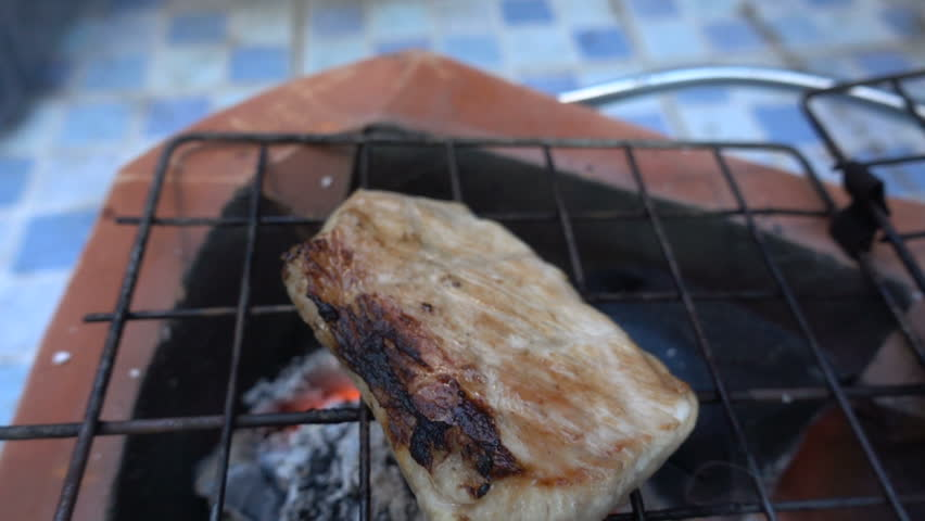 Cooking pork steaks on the grill on fire slow motion | Shutterstock HD Video #25066964