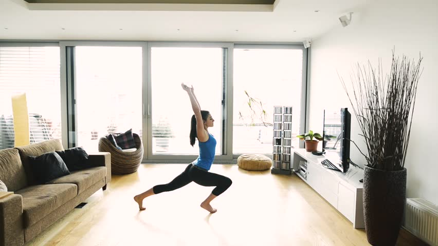 Young woman exercising at home, stretching legs and arms. #25093535