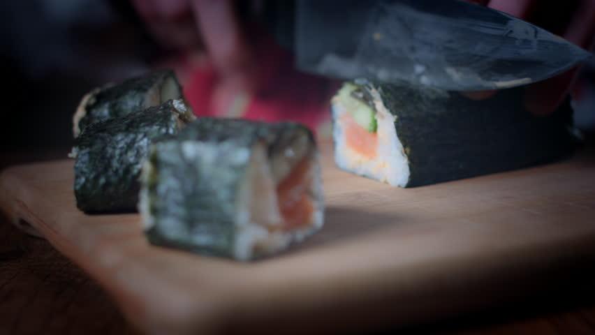 4K Traditional Chef Cutting Fresh Sushi Rolls   Shutterstock HD Video #25112171