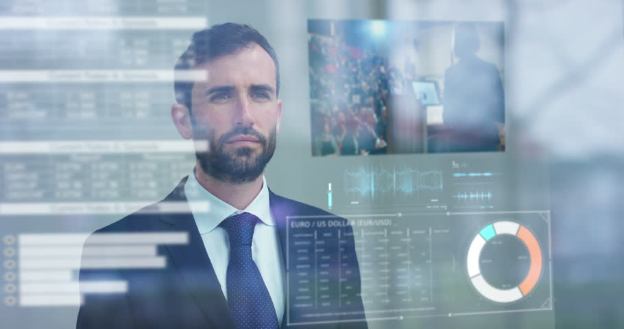A businessman in a suit uses holography and augmented reality to see in 3D graphics financial economics.  | Shutterstock HD Video #25150175