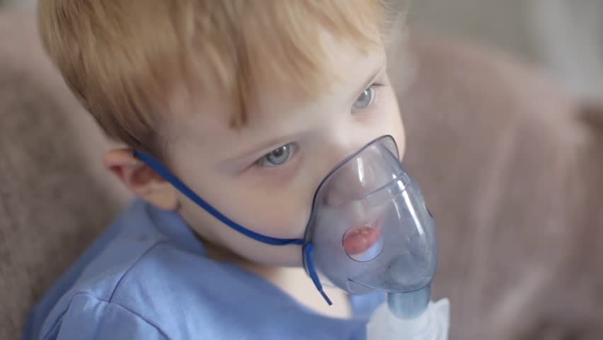 A Little Boy Breathes Through an Inhaler, Heals Himself | Shutterstock HD Video #25153589