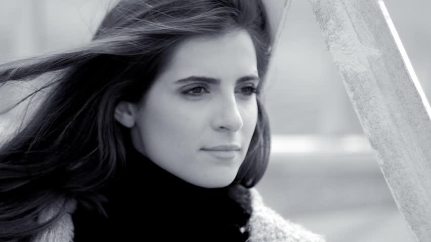 Beautiful female model posing sad on sand black and white fashion shot closeup | Shutterstock HD Video #25153637