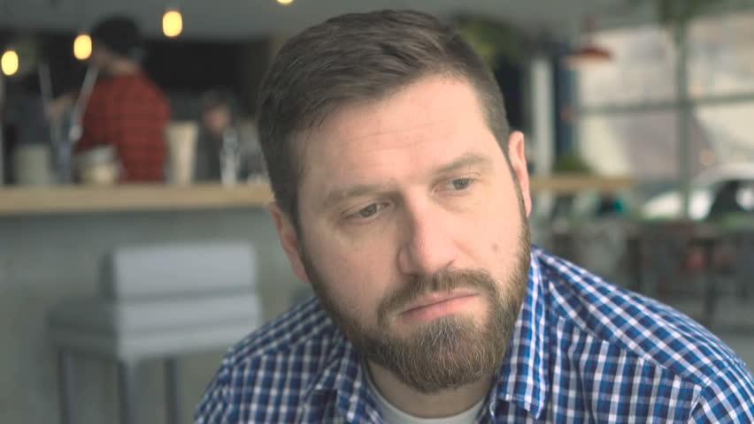 Portrait of pensive, troubled man, in cafe, very close steadicam shot | Shutterstock HD Video #25155917