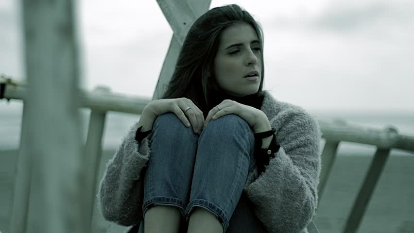 Strong Concept Of Sadness Woman On The Beach Closeup | Shutterstock HD Video #25162940