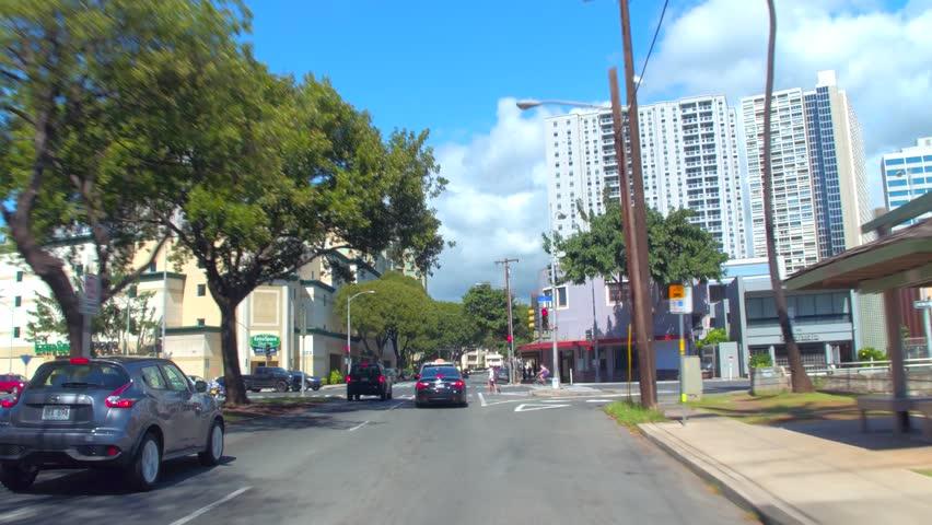 HONOLULU, USA - FEBRUARY 16, 2017: Drivers pov of industrial Downtown Honolulu Oahu Hawaii, USA shot with gimbal camera