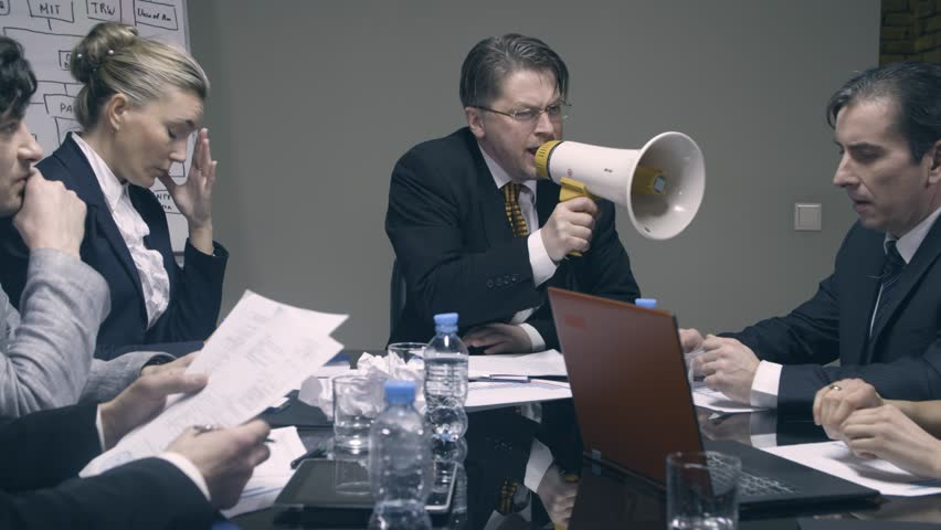 Mad boss yelling at employees with a megaphone