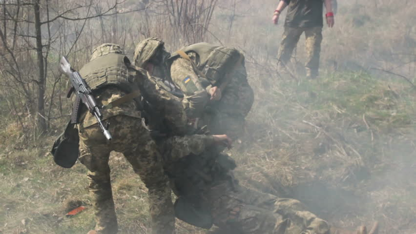 military taking wounded soldier