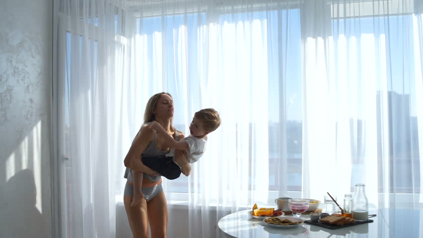 the girl throws the boy and hugs him. Mom is happy with her son #25194983