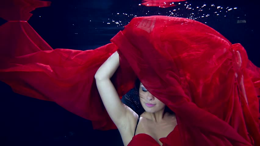 Ecstasy in motion under water. Sexy dance young beautiful girl in zero gravity. Red long dress | Shutterstock HD Video #25201586