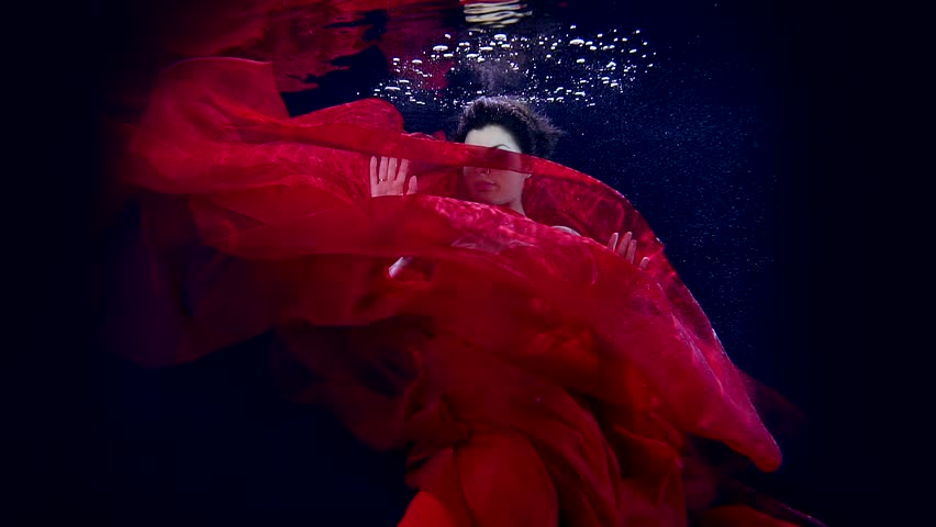 Dance sexy young girl under water in pool Studio contrast lighting. Smooth red cloth of her dress. | Shutterstock HD Video #25201595