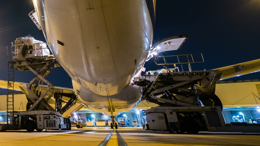 Panning time lapse cargo aircraft loading