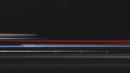 Super fast car lights in minimal style. Motion time lapse colorful urban background texture. Modern cityscape road traffic. Travel concept. Science hyperspeed  teleport movement. Time machine.