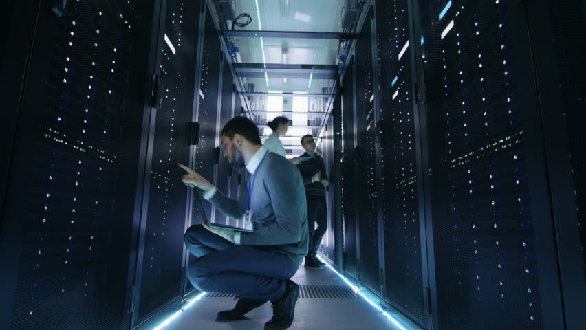Time-Lapse of Male and Female IT Engineers, Server, Technicians and Support Working in Big Data Center. Shot on RED EPIC-W 8K Helium Cinema Camera. | Shutterstock HD Video #25243058