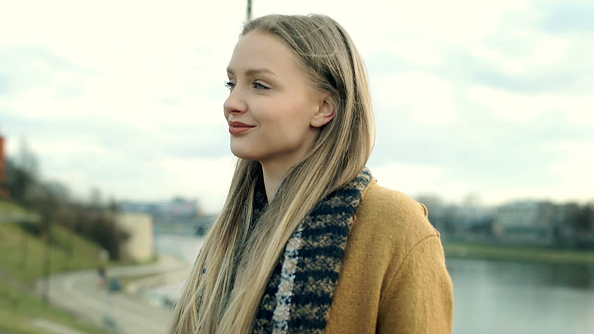Beautiful girl in stylish coat walking on boulevards and sightseeing    Shutterstock HD Video #25245335