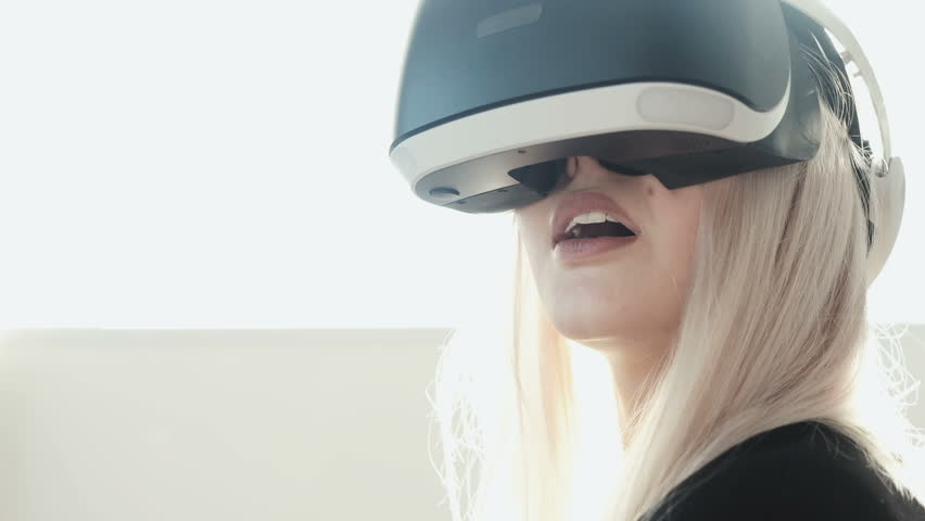 Future is now. Beautiful young female playing game in vr glasses. Beautiful woman touch something using modern virtual reality glasses #25246322