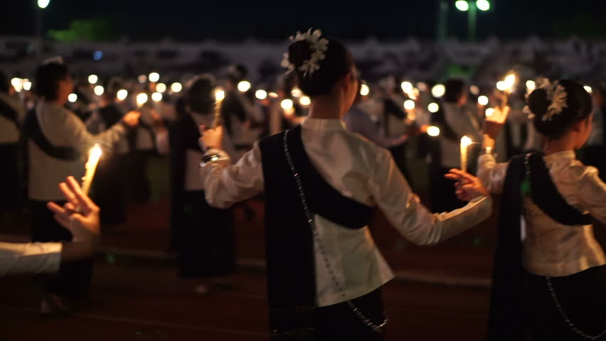 Chiangmai, Thailand - 5 December 2016: Respect condolences candle dance in memory for King Bhumibol Rama iX of Thailand   Shutterstock HD Video #25248641