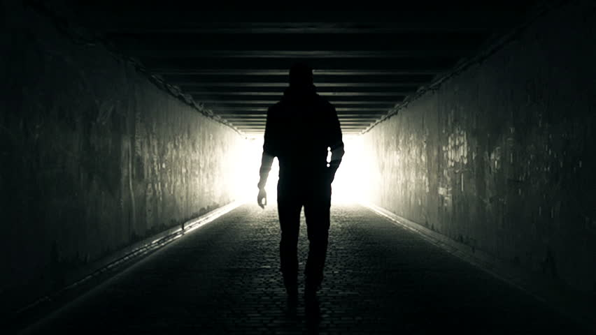 Slow Motion Video of Man walking in Tunnel to the Light | Shutterstock HD Video #25256111