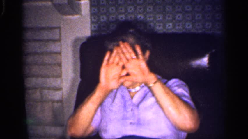 MINNESOTA 1959: spotlight on grandma pretends to be shy, rest of family ignores camera