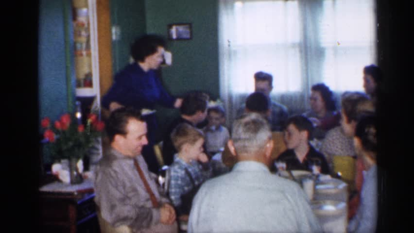 MINNESOTA 1958: big family enjoys dinner around the table while being served by the mother or waitresses #25264376