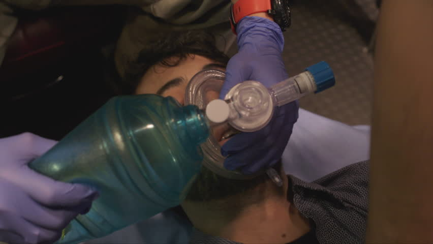 Man being resuscitated with oxygen in ambulance | Shutterstock HD Video #25268396