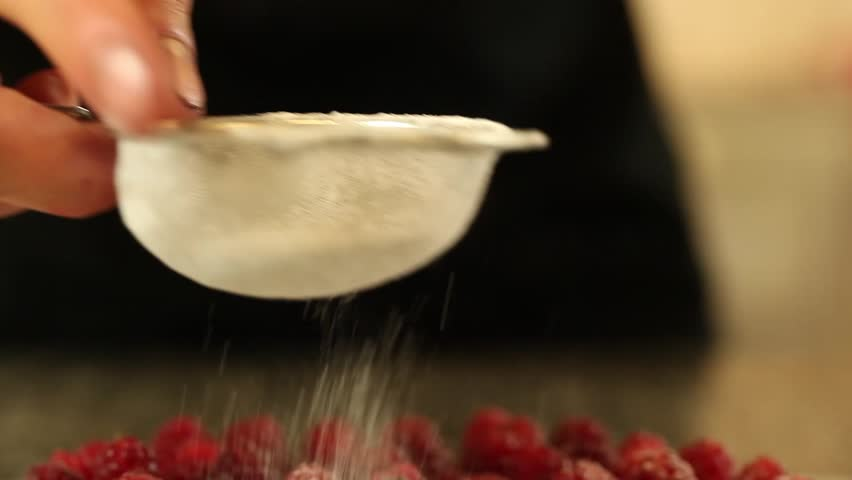 Sugar falls on raspberry tart | Shutterstock HD Video #2527910