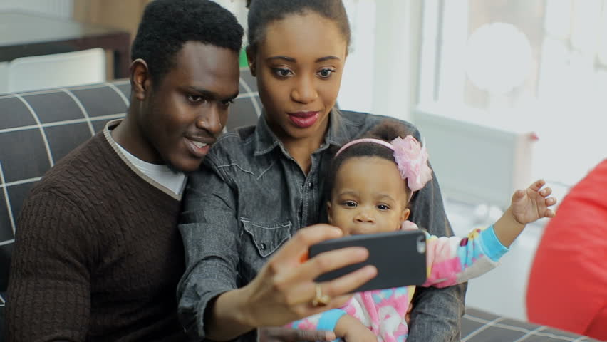 Young african american family make selfie on smart phone #25283999