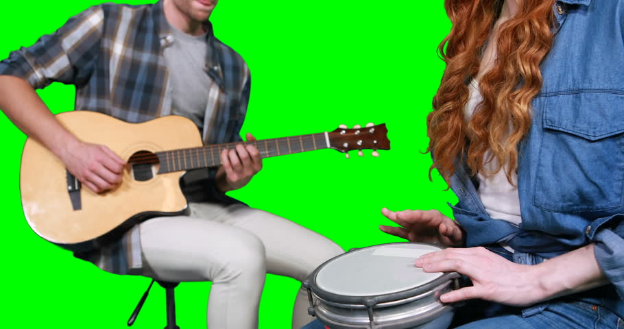 Musicians playing guitar and drum against green screen | Shutterstock HD Video #25293953
