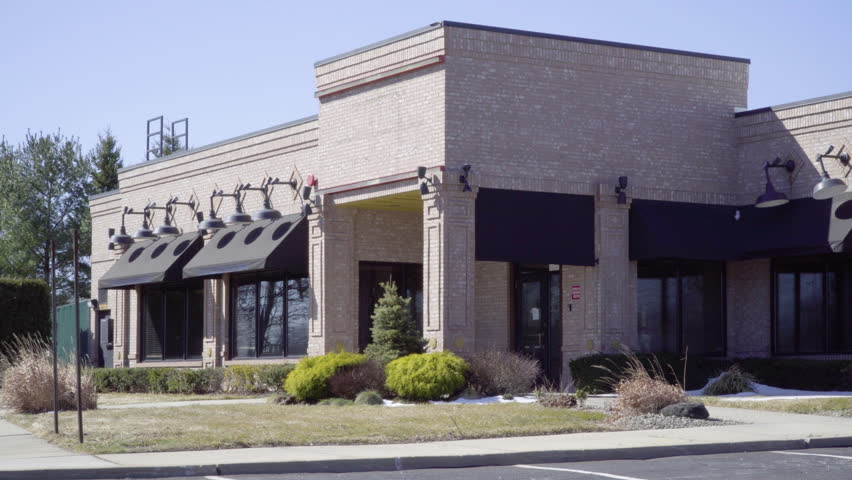 DX restaurant exterior establishing shot day. Outside of generic family stand alone eatery building on sunny wintry day. No people or signage. Blank markings. Day night matching available ID 25295336 | Shutterstock HD Video #25295336