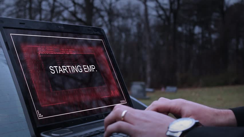 A secret agent or operative activates an EMP on his laptop and flees Royalty-Free Stock Footage #25311518