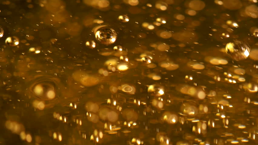 A lot of bubbles in the yellow liquid, slowly rising and bursting, liquid is like beer or oil or drink or fuel, can be applied in any version   Shutterstock HD Video #25325924