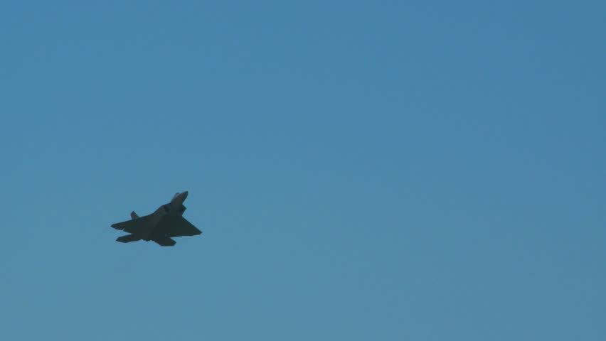 QUONSET, RHODE ISLAND - JUNE 2012: Air force F-22 Raptor flying by while rolling at the Rhode Island National Guard Open House and Air Show in June 2012.