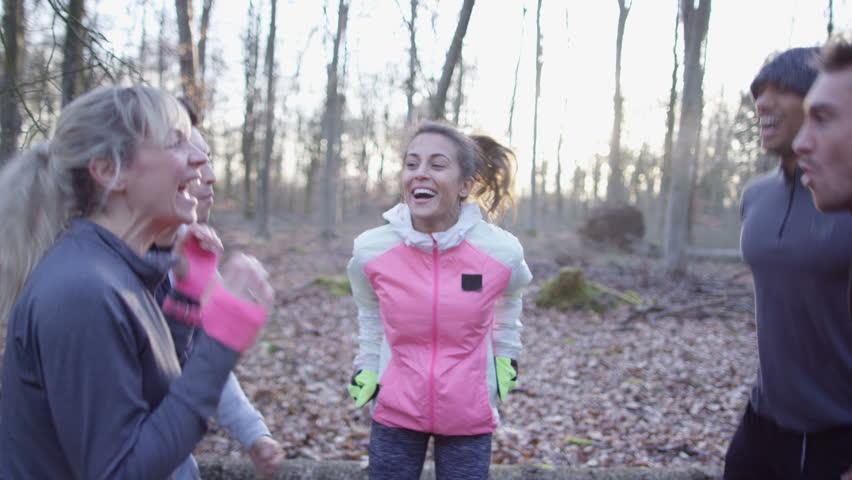 4K Friends on a run in the woods stop for a break & feel the buzz of adrenaline | Shutterstock HD Video #25367477