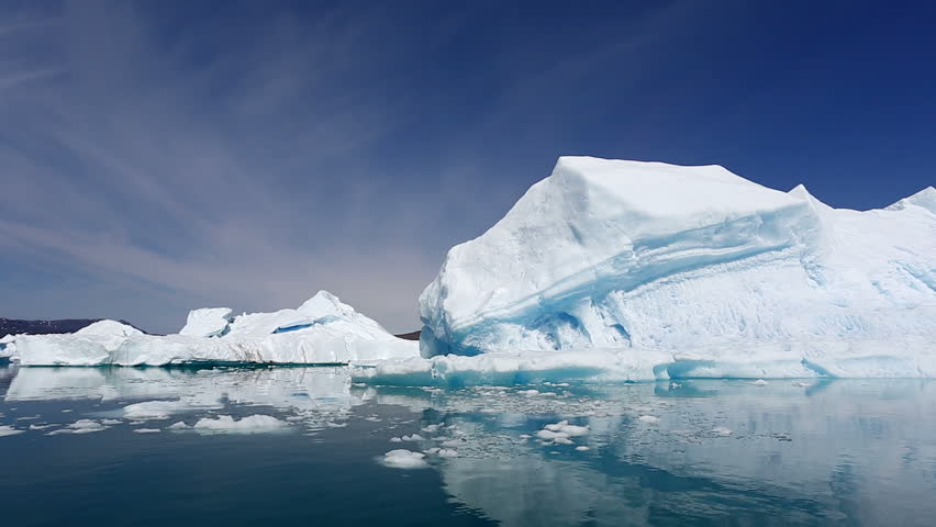 Drifting by an iceberg floating in Qooroq Icefjord, South Greenland