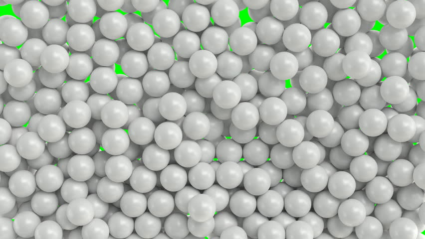 Falling and bouncing a lot of white plain Ping-pong balls against green background. Front camera view