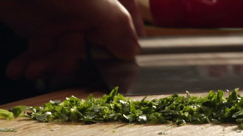 A chef chops parsley