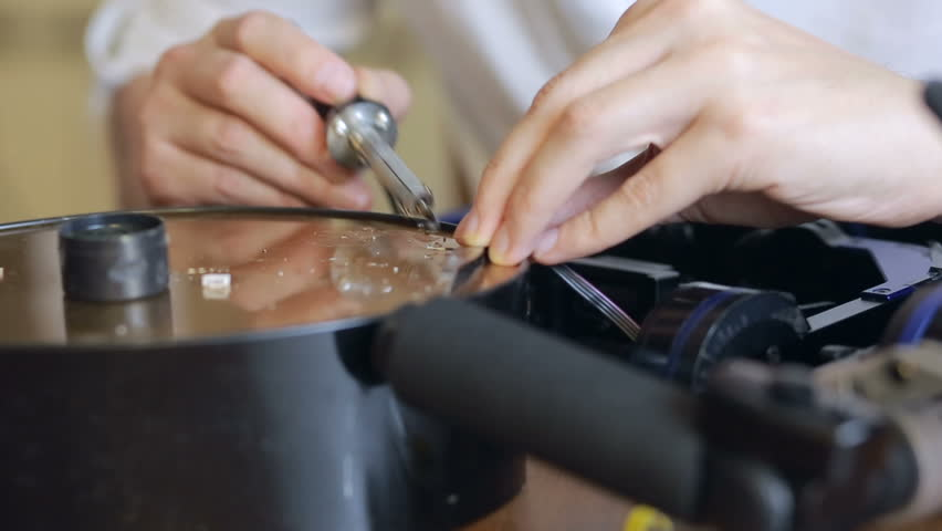Close up of mans soldering wires of cpu #25417733