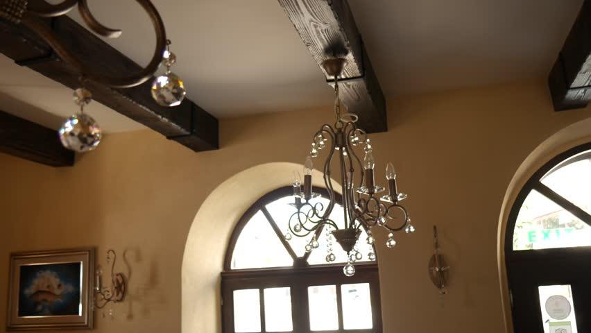 Crystal Chandelier Restaurant. The interior design of the restaurant.   Shutterstock HD Video #25420631