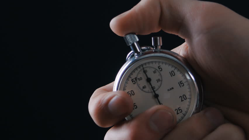 One person starting up a stopwatch at black background