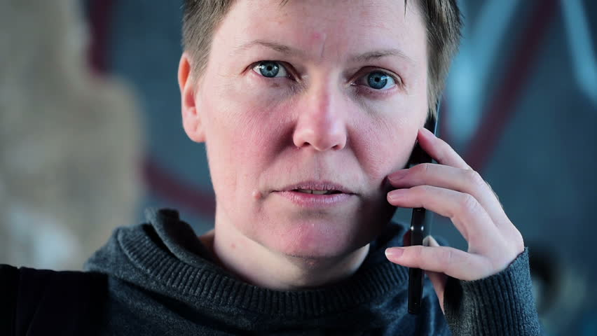 Serious woman talking on mobile phone on the street, hearing bad news, handheld camera with subtle motion | Shutterstock HD Video #25432883