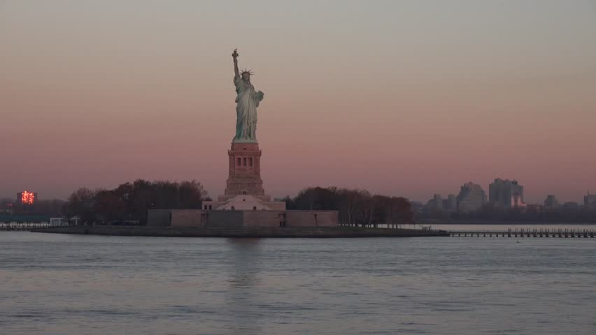 View of the Statue of Liberty and Ellis Island in sunset sunrise, New York State, Manhattan, North America, USA | Shutterstock HD Video #25433993
