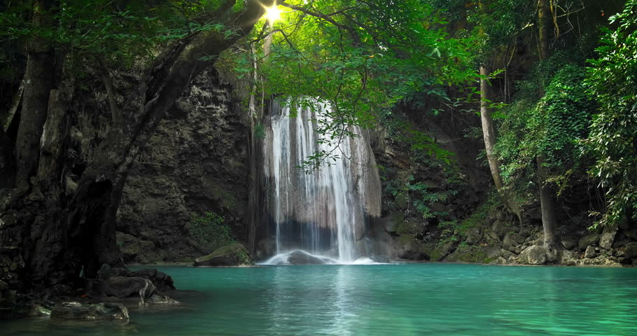 Scenic nature of beautiful waterfall and emerald pool of fresh water lake in wild jungle forest environment in Thailand. Travel and adventure landscape of amazing Asia