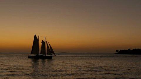 Sailboat cruising at sunset in Key West