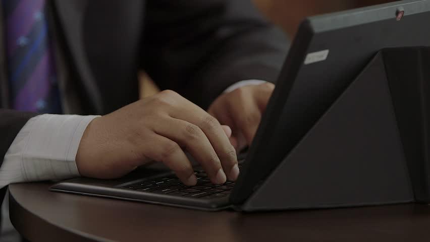 man typing laptop