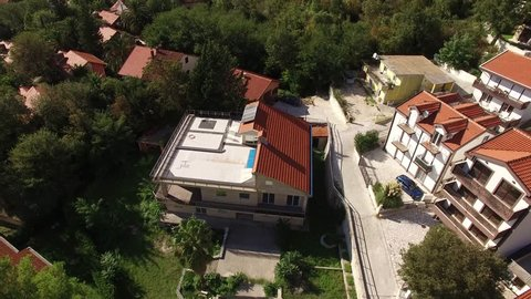 The villa in the mountains near the sea. Montenegro, Bay of Kotor. Shooting from the air, aerial photography drone.