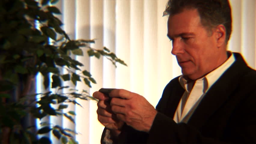 A man using his PDA to communicate via text messaging.  Taken with 35mm adaptor for shallow DOF