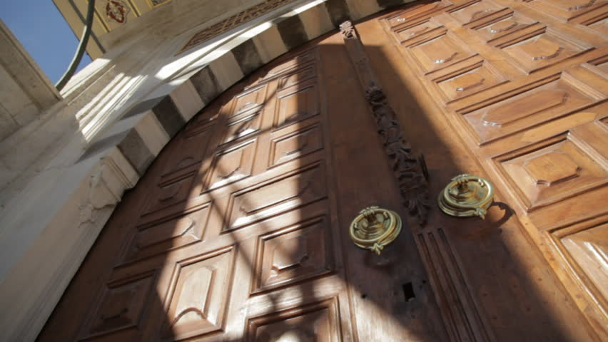 Big wooden arch door of a mosque | Shutterstock HD Video #25490342