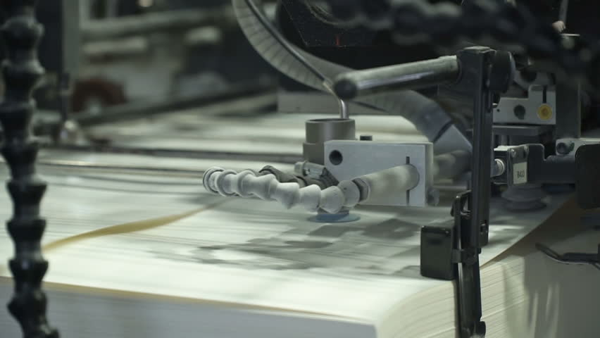 Vacuum sheet feeder supplies individual sheets of paper into printing press from the pile of paper. Related to machinery, technology of printing. Extreme closeup | Shutterstock HD Video #25507454