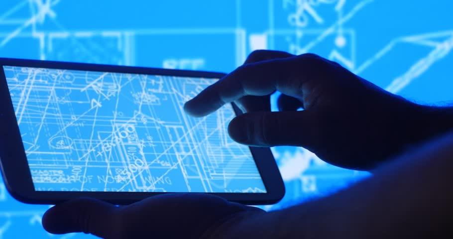 Industry development design blueprint plans on tablet computer.   Shutterstock HD Video #25509410